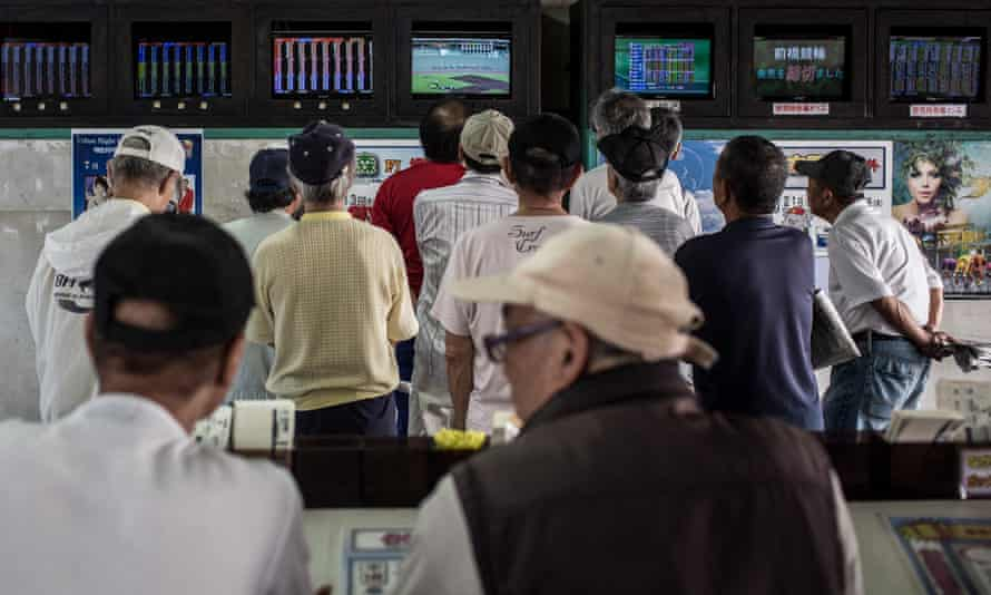 Punters watch a race on the betting screens in 2015. The races are still huge among Japan's gambling fraternity.