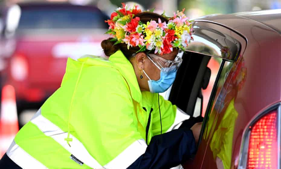 A nurse vaccinates a member of the public during a Cook Islands drive through vaccination community event in Auckland, New Zealand.