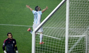 Argentina's Sergio Aguero, top, celebrates after scoring against Paraguay's goalkeeper Justo Villar.