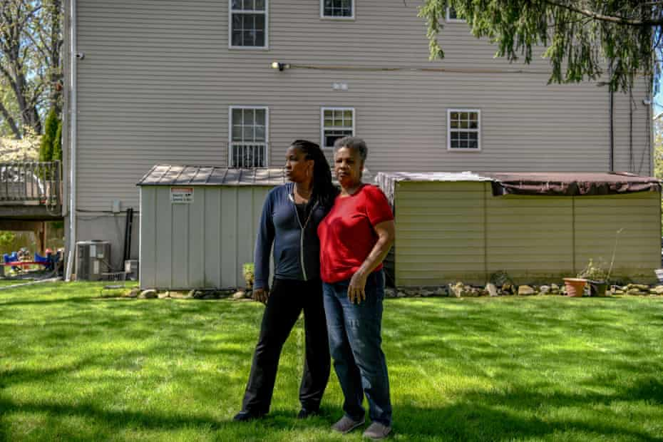 Eileen Lambert (left), 45, and her mother, Linda McNeil (right), 68, pose for a portrait outside of Ms. McNeil's home in south Mount Vernon, New York on Friday, April 23, 2021. Ms. McNeil, a resident of Mount Vernon for 21 years, used a 16-gallon wet vacuum from September 2020 to January 2021 to suck up her toilet and tub water waste after the sewer lines in her neighborhood clogged.