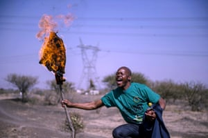 A miner torches his shirt during the third anniversary march last year