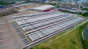 Dozens of Crossrail's new high-tech trains sitting idle in a London depot waiting to be used.