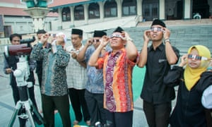 Indonesian Muslim astronomy researchers set up their telescopes on the terrace at the Agung Mosque for the upcoming total solar eclipse.