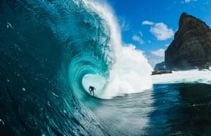 Mikey Brennan surfing through a pipeline