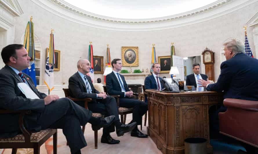 Donald Trump and senior White House staff meeting with Mark Zuckerberg in the Oval Office in September last year.