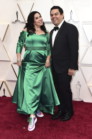 Kristen Anderson-Lopez, left, and Robert Lopez arrive at the Oscars