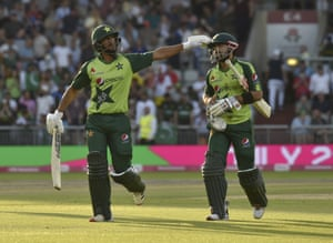 Pakistan's Hasan Ali, left, and Mohammad Rizwan walk off the filed at the end of their innings.