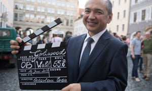 Octavian Ursu of the CDU poses with a film clapperboard outside city hall after winning the second round vote in Görlitz