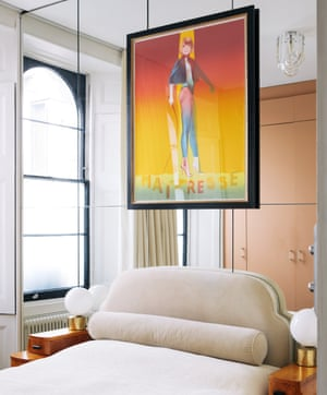 Mirrored wall in a bedroom with a film poster for La Maîtresse mounted on it.