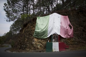 A shrine to the Virgin of Guadalupe is decorated with a Mexican flag on the road leading to Filo de Caballos