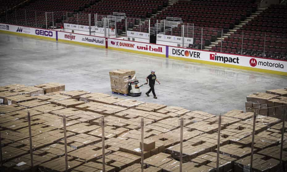A worker moves food onto the floor of the United Center in Chicago, Illinois, on 20 March.