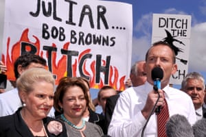 Tony Abbott speaks at an anti-carbon tax rally in front of banners attacking Julia Gillard, 23 March 2011