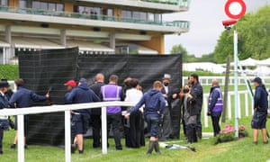 A protest takes place near the winning post at Royal Ascot.