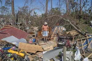 A resident surveys debris after Hurricane Michael hit in Mexico Beach, Florida, U.S., on Friday, Oct. 12, 2018. Search-and-rescue teams found at least one body in Mexico Beach, the ground-zero town nearly obliterated by Hurricane Michael, an official said Friday as the scale of the storm's fury became ever clearer.