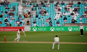 Spectators sit socially distanced at the  friendly county cricket match between Surrey and Middlesex at the Oval.
