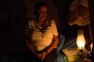 Elvia Helena Lozano uses a kerosene lamp in her home.