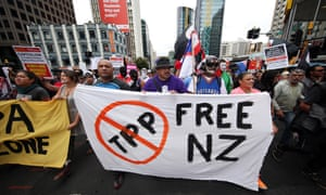 Protesters march to the venue of the Trans Pacific Partnership agreement signing in Auckland on Thursday.