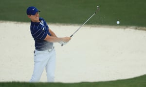 Rory McIlroy playing out of a 10th-hole bunker during his first round at Augusta.