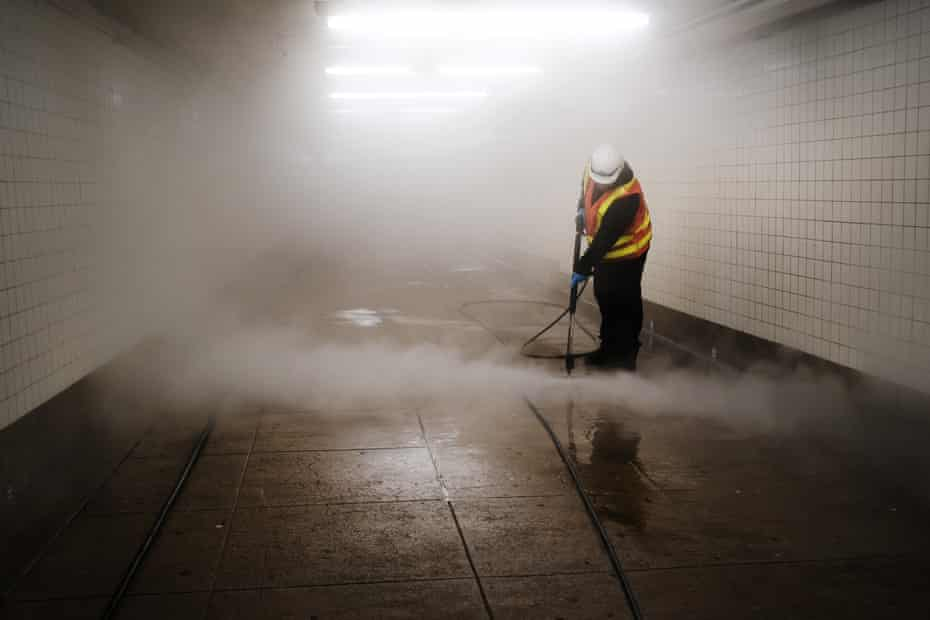 Workers clean a subway station in Brooklyn as New York City confronts the coronavirus outbreak on March 11, 2020 in New York City.