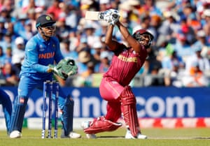 West Indies' Nicholas Pooran hits the shot from which he is caught.