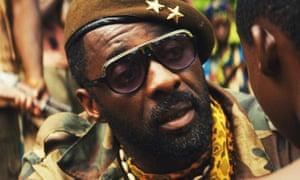 Idris Elba in dark glasses and a cap in Beasts of No Nation.