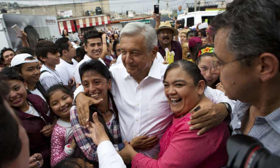 Andrés Manuel López Obrador is surrounded by supporters as he arrives at a campaign event for Delfina Gomez.