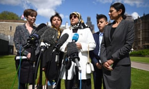 Fatima Boudchar (centre) and her son Abderrahim Belhaj, 14, with lawyers Cori Crider (far left) and Sapna Malik (far right) from Reprieve make a statement outside the Houses of Parliament on Thursday