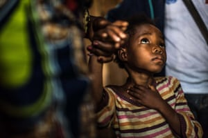 4 year-old Shebilia waits for her vaccination