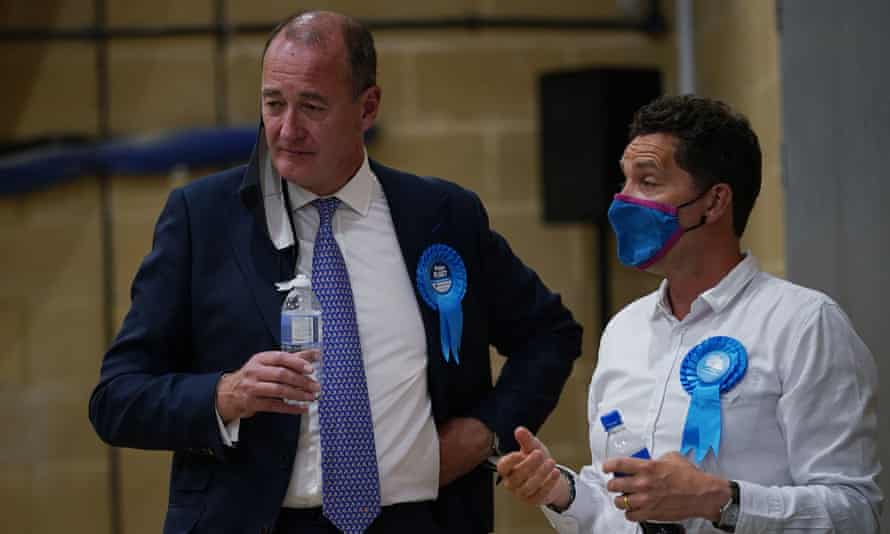 Defeated Conservative candidate Peter Fleet (left) after the byelection declaration at Chesham leisure centre.