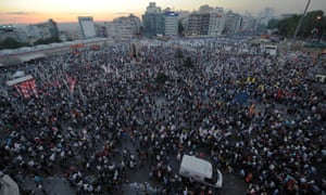 People gather in Istanbul's Taksim Square to protest the development of Gezi Park.
