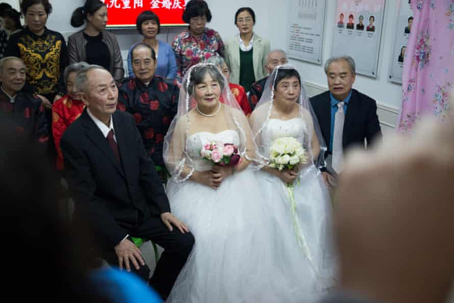 Two couples pose for Frame the Vow
