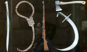 """Banner depicting """"Tools of Genocide"""" forming the shape of """"1915"""", in reference to the year of the mass killings of Armenians by Ottoman Turks, in Yerevan."""