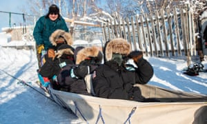 Australian rangers dogsledding with Steve Nitah (at the back) Dene traditional owner and local conservation and development leader. Dog sledding was a key means of transport for traditional owners. Yellowknife, Canada.