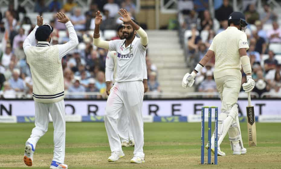India's Jasprit Bumrah, centre, celebrates the dismissal of England's Stuart Broad, right, as England's batting order capitulated on the opening day at Trent Bridge
