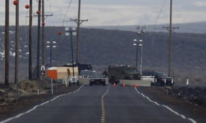 Law enforcement personnel man a checkpoint closing Highway 205 to most traffic on the Malheur national wildlife refuge outside Burns, Oregon.