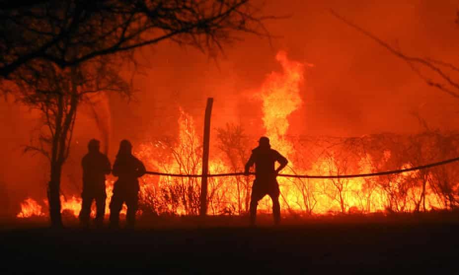 Firefighters tackle a blaze in San Antonio de Arredondo, Córdoba province, Argentina, September 22, 2020.