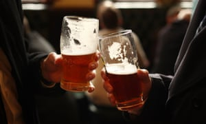 Drinkers with beer glasses in a pub