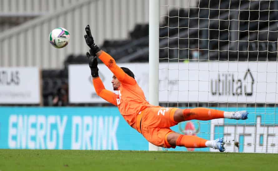 Derby goalkeeper Kelle Roos makes a save from Barrow's Tom Beadling in the penalty shoot-out.