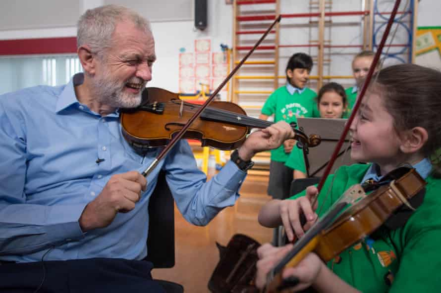 Jeremy Corbyn being given a violin lesson during a visit to Faith Primary School in Liverpool, 27 September 2016.