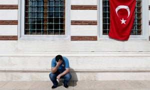A man mourns after the death of 41 people killed at Istanbul's Ataturk Airport