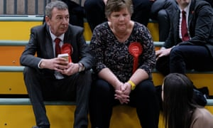 Labour MP Mike Hill, left, sits with party members during the count in Hartlepool.