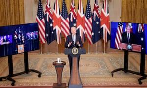 biden speaks flanked by TVs with Boris Johnson and Scott Morrison speaking