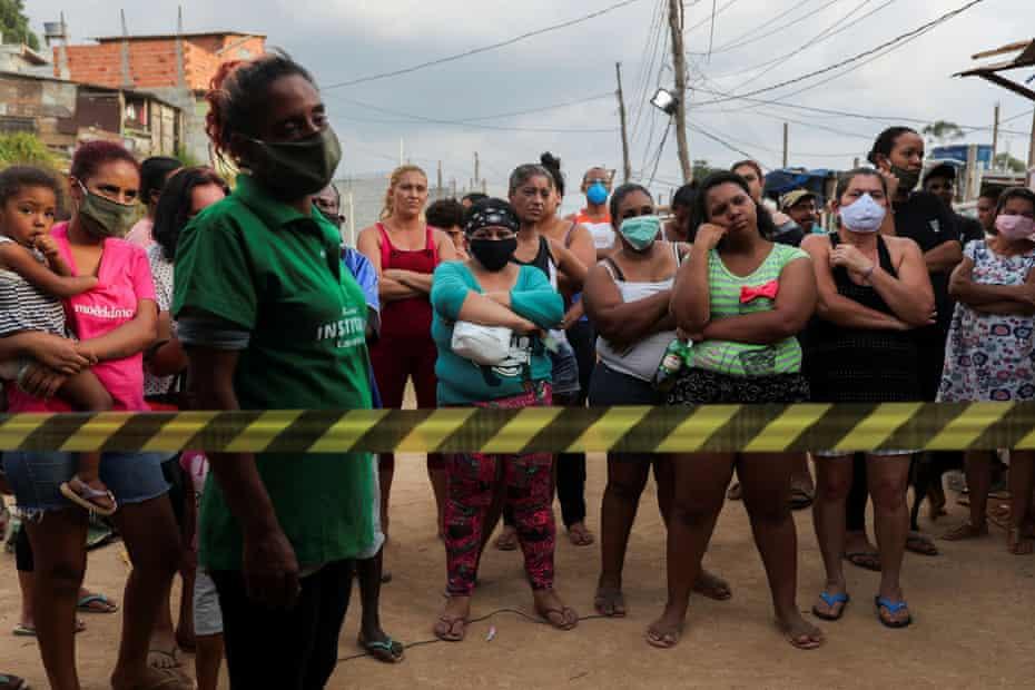 Residents wait for food donations in Brasilândia, São Paulo.
