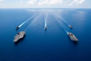 US Navy ships from Ronald Reagan Carrier Strike Group and Boxer Amphibious Ready Group sailing in formation in the South China Sea, 06 October 2019.
