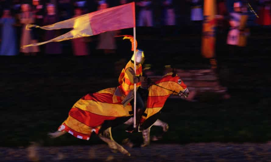A medieval knight rides through the grounds of Auckland Castle.