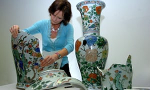 Ceramic Conservator Penny Bendall works on one of three monumental Chinese Porcelain Vases at the Fitzwilliam Museum in Cambridge, Wednesday March 29 2006. T