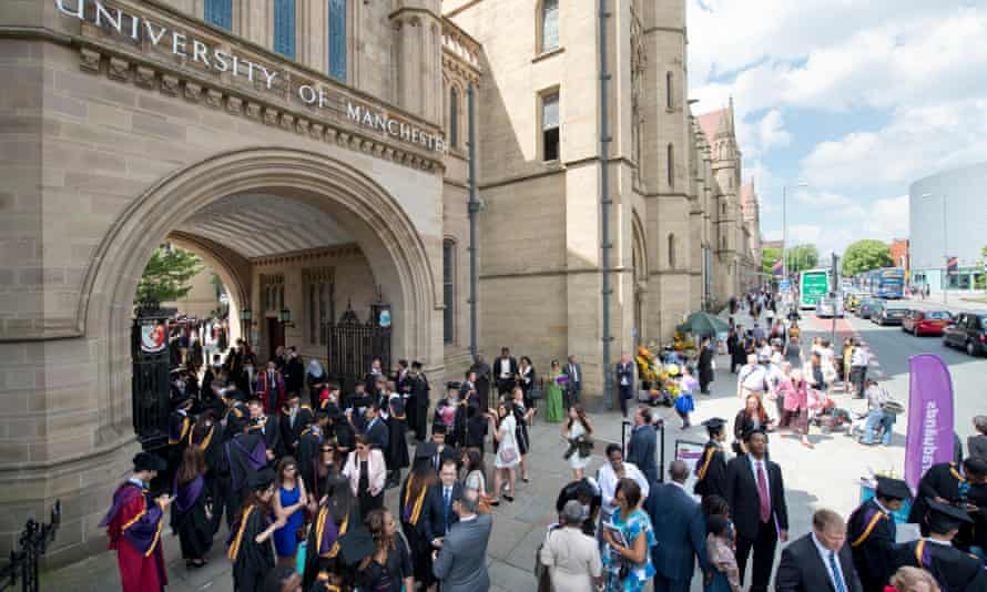 Manchester University students attend their graduation ceremony
