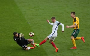 Vardy loft the keeper, but it goes over.