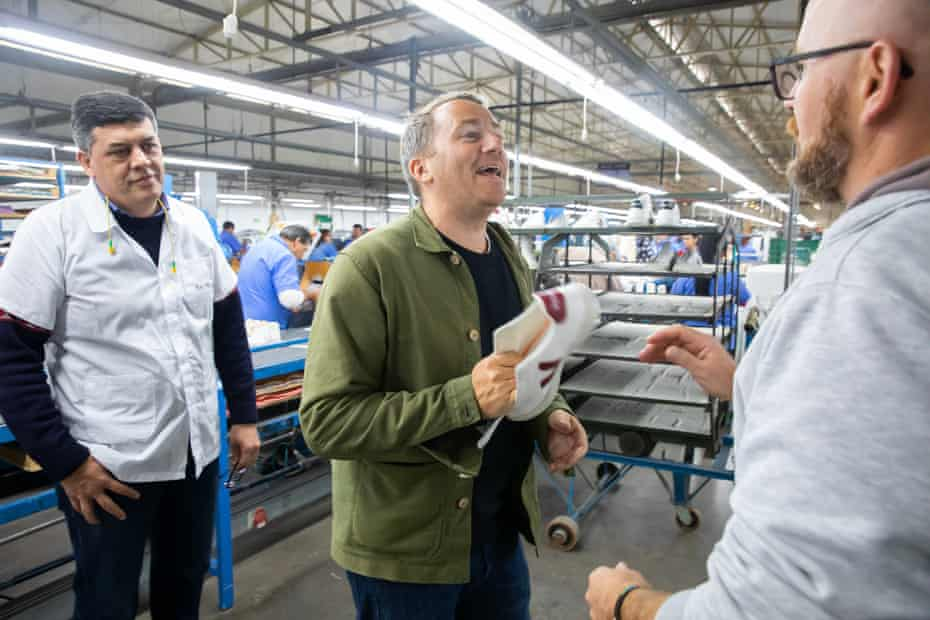 François Ghislain Morillion, co-founder of Veja (centre) discusses the latest shoes with factory managers.