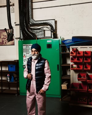 Arvinder Singh Marway, 56, laboratory technician, Ford Dunton Technical Centre, wears MC Overalls pink jumpsuit at his workplace
